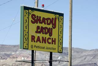 A sign for the Shady Lady Ranch brothel in Nye County. The Shady Lady, off U.S. Highway 95 about 30 miles north of Beatty, was the first brothel to hire a male prostitute. Nye County is one of 11 Nevada counties where prostitution is legal.
