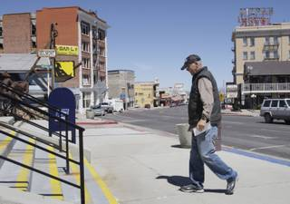 Tonopah resident Jerry Clark heads to check his mail at the post office.