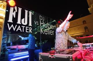 Chef Hubert Keller spins in the Fiji Water DJ Booth at the Vegas Uncork'd Grand Tasting at Garden of the Gods in Caesars Palace on May 7, 2010.