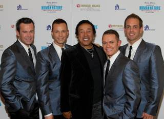 Smokey Robinson is flanked by Human Nature at the Imperial Palace on May 11, 2010.