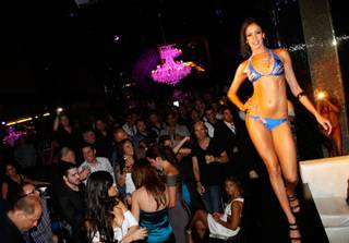 A Fantasy dancer walks the runway for the Laguna Beach Jeans Co. swimwear fashion show at Eve in Crystals at CityCenter on May 15, 2010.