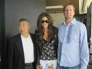 2010 Playmate of the Year Hope Dworaczyk with Sung Cha and Peter Cosovich.