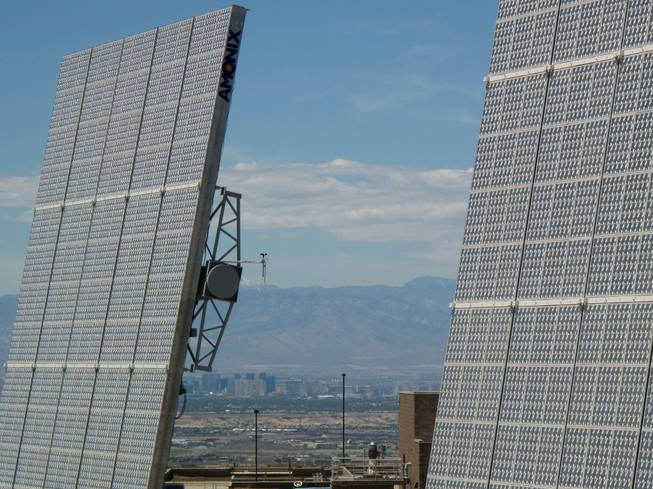 The Las Vegas Valley is seen between two solar panels at the Southern Nevada Water Authority's River Mountains Water Treatment Facility in Henderson.