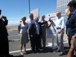Sen. Harry Reid helps ceremonially activate a solar power plant Saturday with, from left, SNWA General Manager Pat Mulroy, TWC Construction CEO Matt Ryba, Amonix founder Vahan Garboushian and Amonix CEO Brian Robertson.