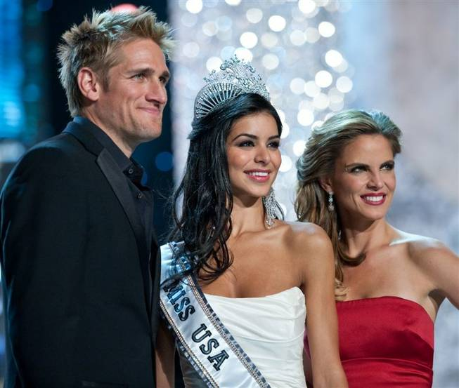 Miss USA 2010 Rima Fakih, center, poses for photos with hosts Curtis Stone and Natalie Morales after winning the 2010 Miss USA Pageant at Planet Hollywood on May 16, 2010.