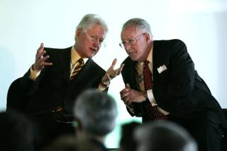Former President Bill Clinton speaks with Mayor Oscar Goodman on Wednesday during an event to announce the first LEED Gold certified retrofit of a building in Nevada.