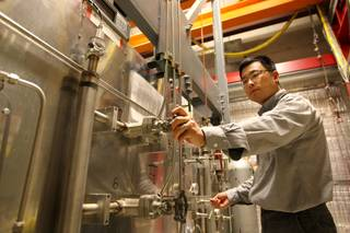 Assistant Research Professor Jian Mia adjusts external gas control valves transferring liquid metal from a storage tank to a circulation loop Friday, May 21, 2010, while working in his lab on the UNLV Campus.