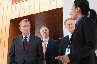 Las Vegas Chamber of Commerce CEO Matthew Crosson, from left, LVCC State Policy Task Force Chairman Steve Hill and CCSD Superintendent Walt Rulffes listen to Principal Felicia Nemcek while taking a tour of the campus of Southwest Career & Technical Academy Thursday, May 27.
