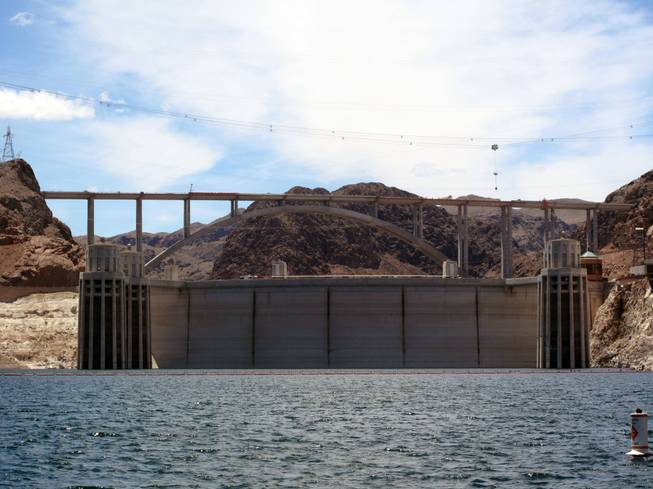 The Hoover Dam bypass bridge towers over the dam and Lake Mead on Thursday.