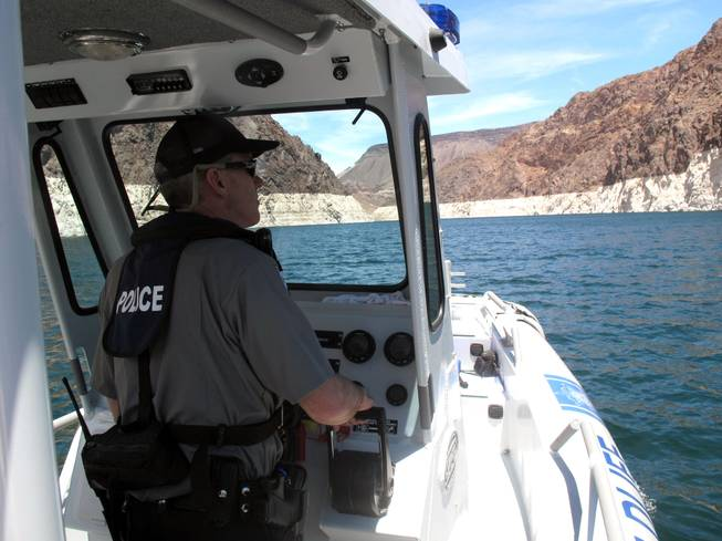 Nevada game warden Lt. Mike Maynard patrols Lake Mead Thursday.