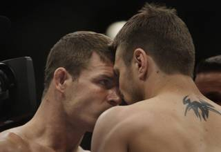 Michael Bisping, left, of England goes face to  face with Dan Miller of New Jersey before their middleweight bout during UFC 114 on Saturday at the MGM Grand Garden Arena. Bisping won by unanimous decision.