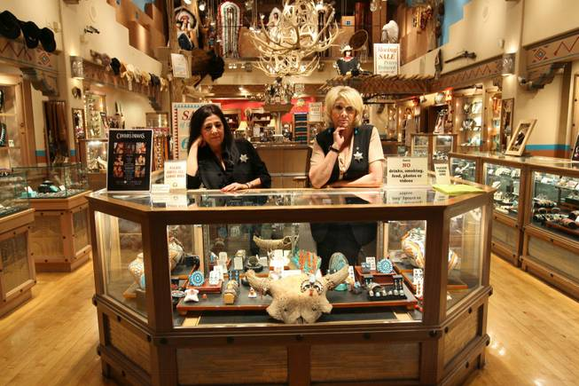 Store manager Sylvia Miller and sales clerk Phyllis Beauchmin stand behind the counter waiting for customers during the closing sale, Wednesday, May 26th, at West of Santa Fe in the Forum Shops at Caesars. Longtime employees Miller and Beauchmin have worked at West of Santa Fe for 13 and 4 years, respectively.