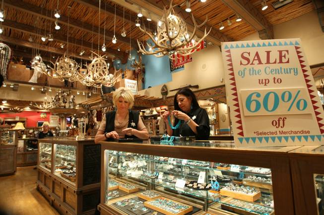 Sales clerk Phyllis Beauchmin and manager Sylvia Miller, right, organize turquoise jewelry in preparation for the final day of business, May 31st, at West of Santa Fe in the Forum Shops at Caesars.