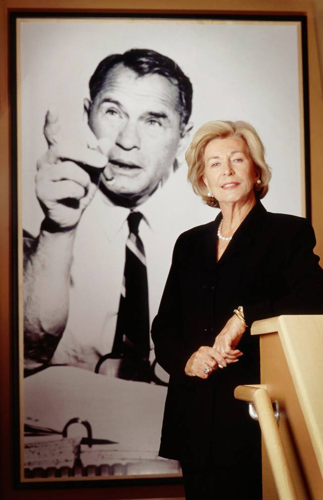 Las Vegas Sun Publisher Barbara Greenspun poses in front of a portrait of her late husband and Sun founder Hank Greenspun in the offices of Greenspun Media Group. June 2000.