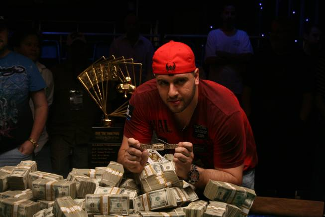 "Michael ""The Grinder"" Mizrachi poses with his newly acquired World Series of Poker gold bracelet and $1.5 million in prize money after winning the 2010 Poker Player's Championship Wednesday morning at the Rio."