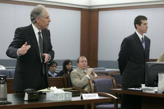 Attorney Richard Wright makes a case to keep his client, Dr. Dipak Desai, out of custody after Desai was indicted by a grand jury Friday, June 4, 2010. On the right is deputy district attorney Michael Staudaher.