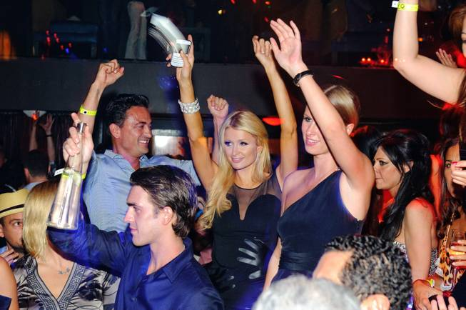 Paris Hilton and Nicky Hilton help celebrate the birthday of their friend Allison Melnick with a custom cake at Tao in The Venetian on June 4, 2010.