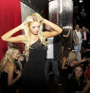 Paris Hilton parties at Drai's Hollywood. At right are Victor Drai and Cy Waits.