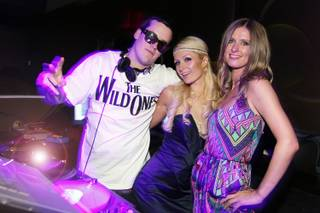 DJ Marshall Barnes, Paris Hilton and Nicky Hilton at Pure in Caesars Palace on June 12, 2010.