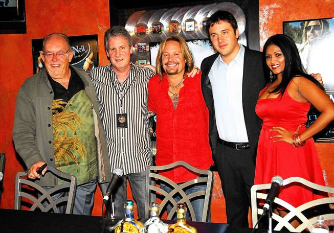 Robin Leach, Ken Ciancimino, Vince Neil, Ben Greenberg and Reisha Roopchand at the grand opening of Vince Neil's Tres Rios in the Las Vegas Hilton on June 12, 2010.