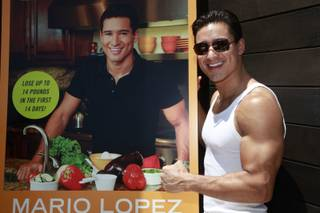 Mario Lopez, accompanied by girlfriend Courtney Mazza, hosts at Liquid Pool Lounge in Aria on June 18, 2010.