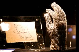 One of five Swarovski crystal-studded gloves made for Michael Jackson for the 1984 Victory Tour and an autograph made the day before he died are displayed at Julien's Auctions annual summer sale at Planet Hollywood. The glove eventually was sold for $160,000. The auction, which continues through Sunday, features 1,600 items from celebrities including Jackson, Anna Nicole Smith, Marilyn Monroe, Cher, Elvis Presley and Star Trek creator Gene Roddenberry.