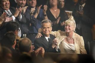 Dick Clark receives a standing ovation during the 37th Annual Daytime Emmy Awards at the Las Vegas Hilton on June 27, 2010. His wife Kari Wigton is at right.