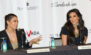 Kourtney Kardashian and Kim Kardashian announce their retail store Kardashian Khaos during a news conference at The Mirage on June 28, 2010.