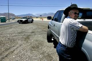 A man who declined to be identified waits out an evacuation for a fire on Mount Charleston Thursday, July 1, 2010.