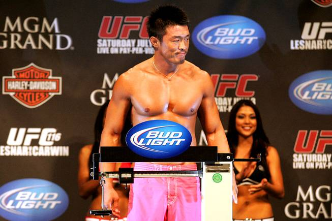 Yoshihiro Akiyama stands on the scale during the weigh in for UFC 116 Friday, July 2, 2010. Akiyama will fight Chris Leben in a middleweight bout on Saturday.