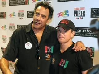 Brad Garrett and Matt Damon walk the red carpet during Ante Up for Africa at The Rio on July 2, 2010.