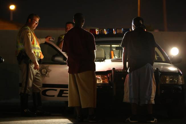 Unidentified passengers are questioned by Metro Police officers after the driver of their vehicle was stopped for suspected impairment July 2, 2010, at a DUI checkpoint on Nellis Boulevard south of East Lake Mead Boulevard.