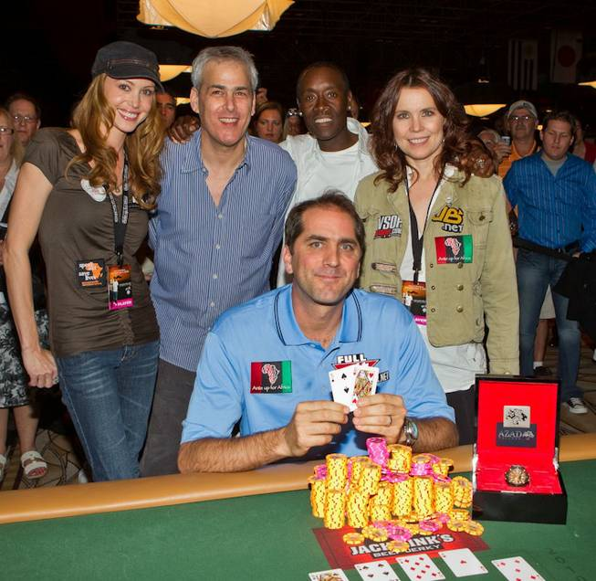 Tournament runner-up Shannon Elizabeth, Norman Epstein, Don Cheadle, Annie Duke and champion Phil Gordon, seated, at Ante Up for Africa at The Rio on July 2, 2010.