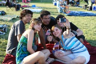 Good buddies strike a pose for a group photo while hanging out together Saturday evening at Seastrand Park during the 11th Annual Independence Day Jubilee in North Las Vegas. Counterclockwise are  Lexeie Chick, Mike Yee, Hector Jeter, Taylor Chick and Brianna Chick.