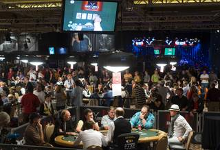 Poker players are shown during the first day of the 41st annual World Series of Poker no-limit Texas Hold 'em main event Monday, July 5, 2010. The tournament started with 7,319 players and is down 27.