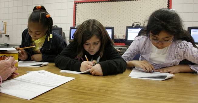 Students, from left, Alanna Holmes, Jennifer Lopez and Joelda Segovia use a Response to Intervention lab at Adams Elementary, an empowerment school, in February.