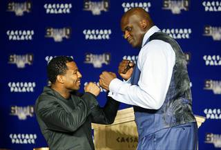 Boxer Shane Mosley and basketball great Shaquille O'Neal pose during a pre-fight
