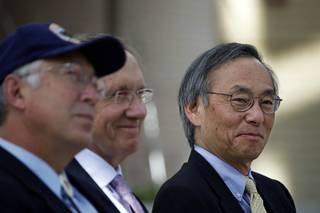 Secretary of Interior Ken Salazar, left, Senate Majority Leader Harry Reid (D-Nev.), center, and Secretary of Energy Steven Chu wait to announce a Nevada Test Site solar power development zone during a news conference at UNLV's Greenspun Hall Thursday, July 8, 2010.