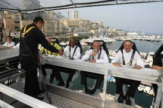 Star-rated chefs sit at a table suspended at a height of 30 meters (about 98 feet), above the harbour of Monaco, Friday, July 9, 2010, as they test out the privileged diner facilities on this high-flying restaurant at the heart of the Monaco Principality.
