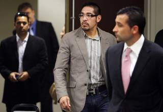 Boxer Antonio Margarito, center, arrives for a licensing hearing with the Nevada State Athletic Commission at the Sawyer State Building Friday, July 9, 2010. The commission disabled his application and recommended that he apply to get licensed in California first.