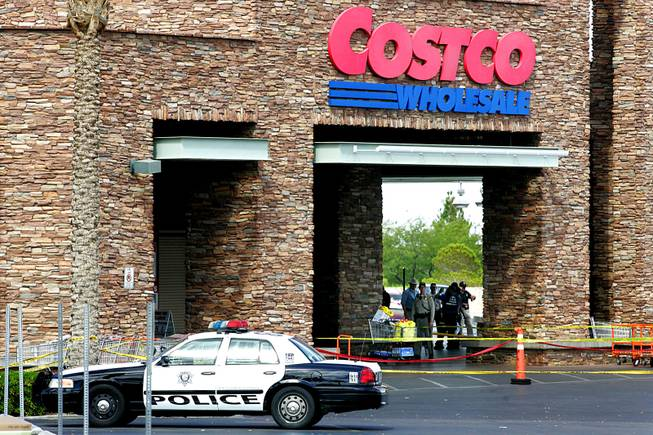 Metro crime scene investigators, officers and detectives mill about the entrance of the Costco store in Summerlin after the shooting July 10, 2010.