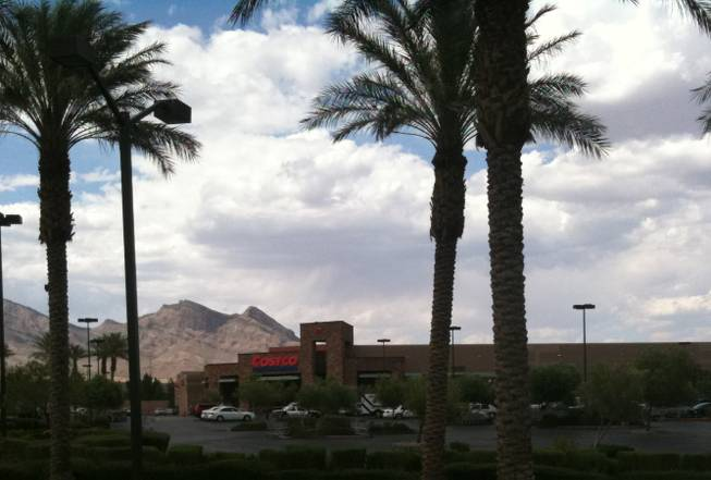 Metro Police officers investigate an officer-involved shooting Saturday afternoon at the Costco store in Summerlin.