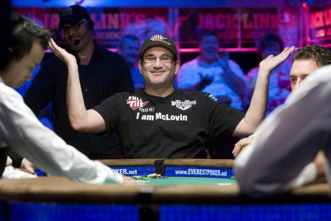 "Mike ""The Mouth"" Matusow, wearing a Full Tilt Poker.net logo, celebrates a winning hand July 5 at the World Series of Poker."