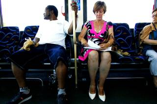 While riding a bus to North Vista Hospital to inquire about any open positions, Peggy Tauber arranges her resumes and paper work while job searching Tuesday, July 13, 2010.