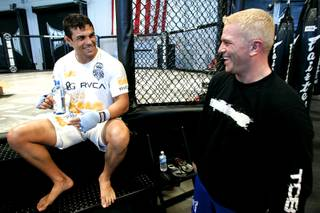 Brazilian middleweight Vitor Belfort jokes with trainer Shawn Tompkins before a workout Wednesday, July 14, 2010.