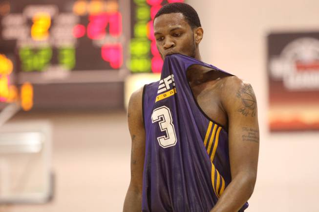 Devin Ebanks of the Lakers bites his jersey after being called for a foul basket during an NBA Summer League game against the Spurs Thursday at the Cox Pavilion.