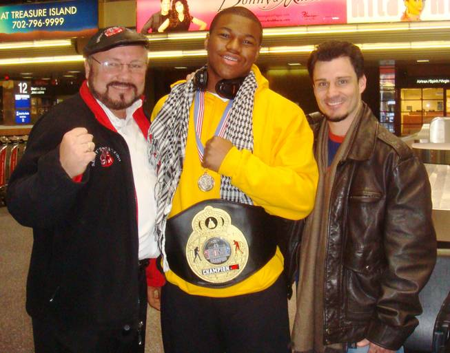 Las Vegas amateur boxer Deyon Christie (middle) poses with coaches Pat Barry (left) and Augie Sanchez (right).