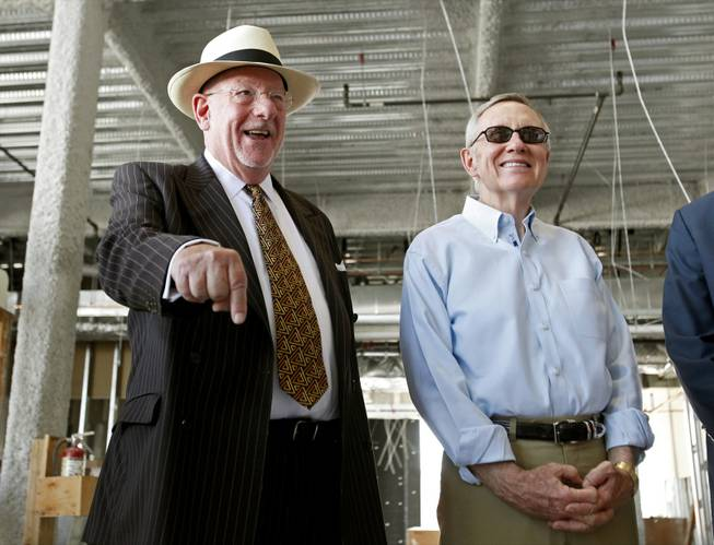 Las Vegas Mayor Oscar Goodman, left, and Sen. Harry Reid tour construction of the Smith Center on Saturday. Reid faces Republican and Tea Party favorite Sharron Angle this November in his bid to keep representing Nevada.