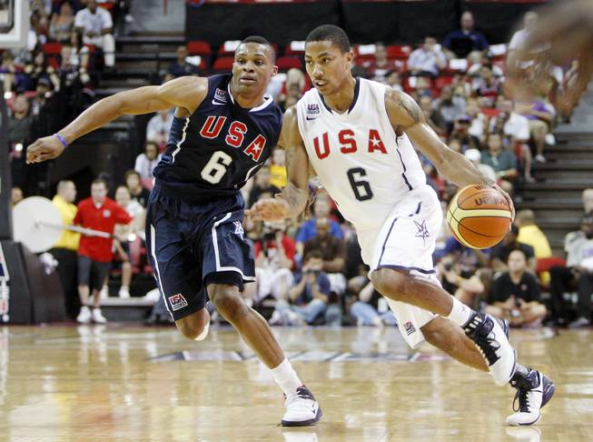 Russell Westbrook, left, covers Derrick Rose, right, during a USA Basketball men's national team exhibition game in Las Vegas, July 24, 2010.