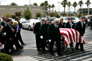 The body of former Governor Kenny Guinn is carried into St. Joseph, Husband of Mary Roman Catholic Church before the start of funeral services, Tuesday, July 27, 2010. Guinn passed away last Thursday while working on the roof of his Las Vegas home.